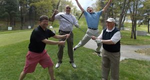 golfers jumping in the air