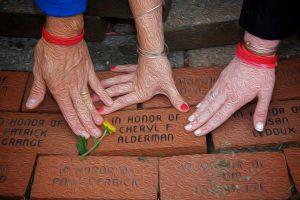 Hands on memorial bricks