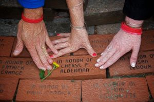 Hands on memorial bricks